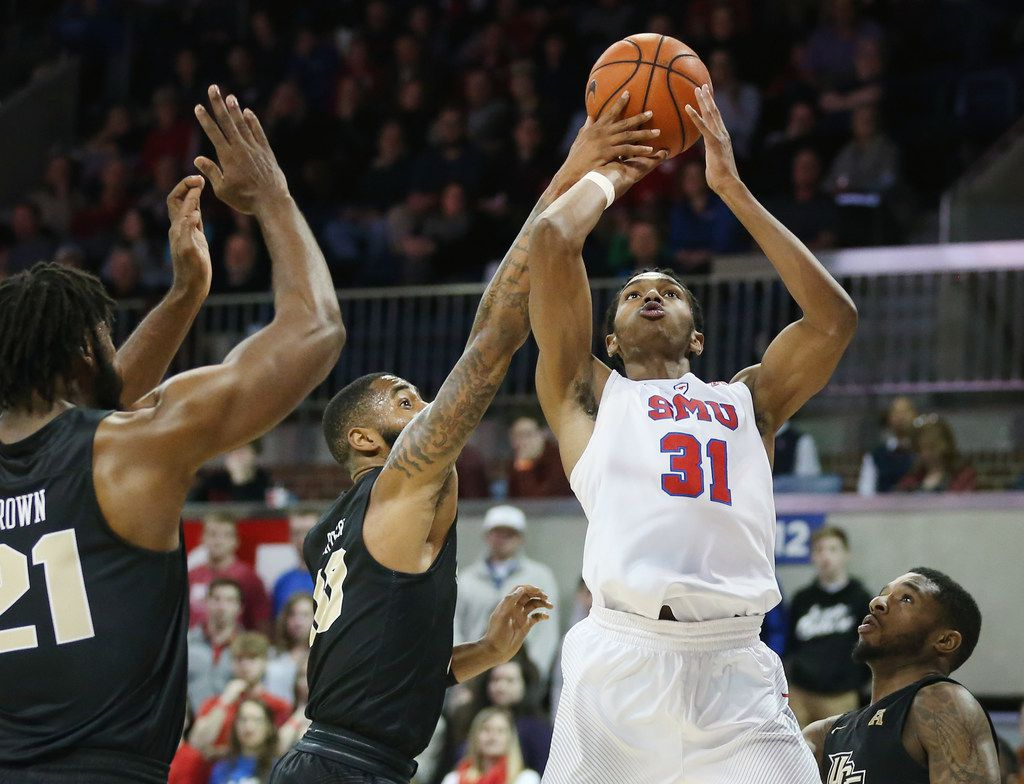 UCF Knights guard Dayon Griffin (10) blocks a shot by Southern Methodist Mustangs guard Jimmy Whitt (31) in the first half of an NCAA basketball game between University of Central Florida and SMU at Moody Coliseum on the campus of Southern Methodist University in Dallas Wednesday December 27, 2017. Southern Methodist Mustangs led 26-21 at the half. (Andy Jacobsohn/The Dallas Morning News)
