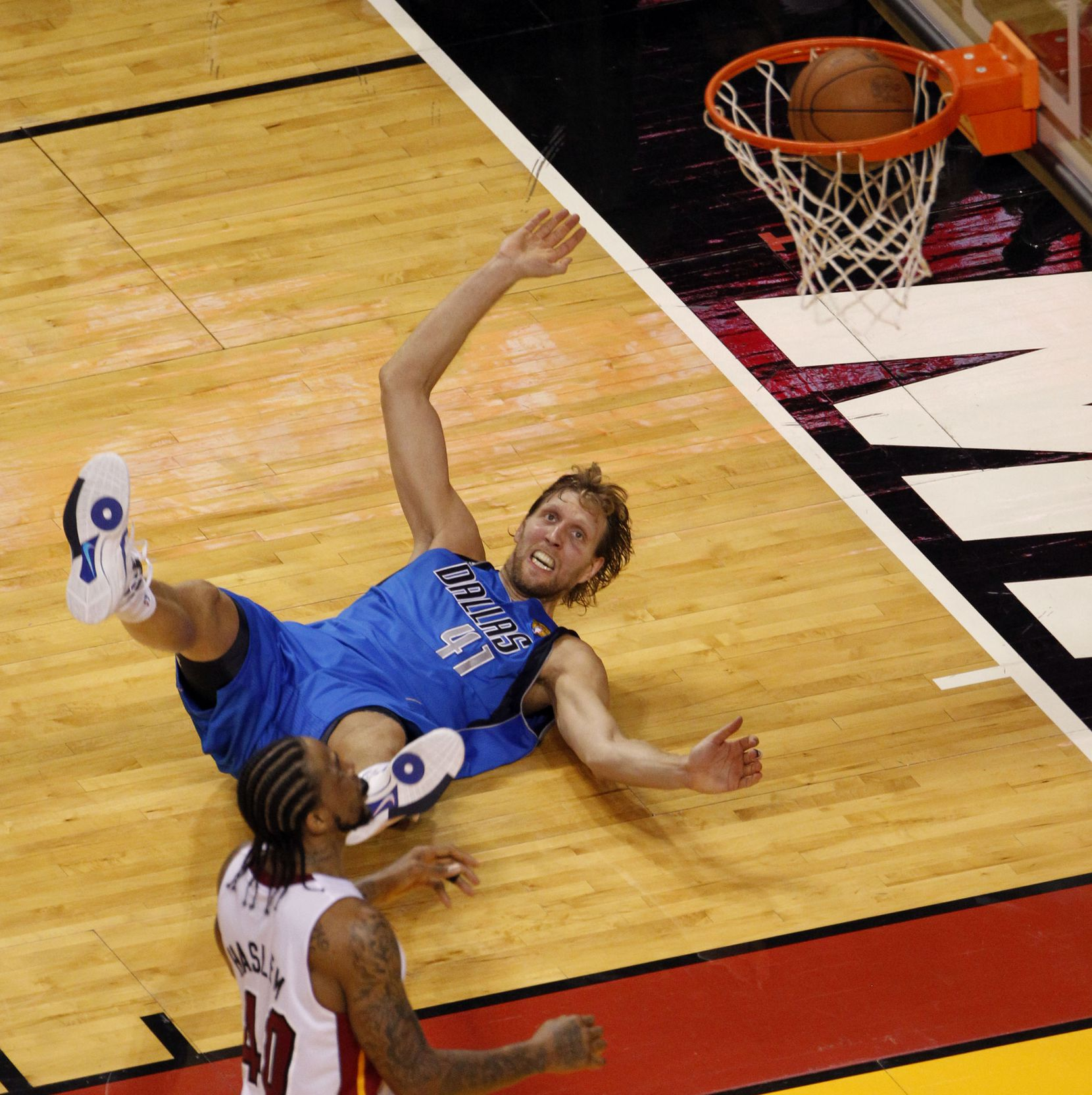 Dallas Mavericks power forward Dirk Nowitzki (41) watches as his shot falls through the basket on a shot defended by Miami Heat power forward Udonis Haslem (40) during the fourth quarter of game six of the NBA Finals between the Miami Heat and the Dallas Mavericks at the American Airlines Arena in Miami, Florida, June 12, 2011. Mavs win 105-95(Vernon Bryant/The Dallas Morning News) 06142011xMAVSspecial