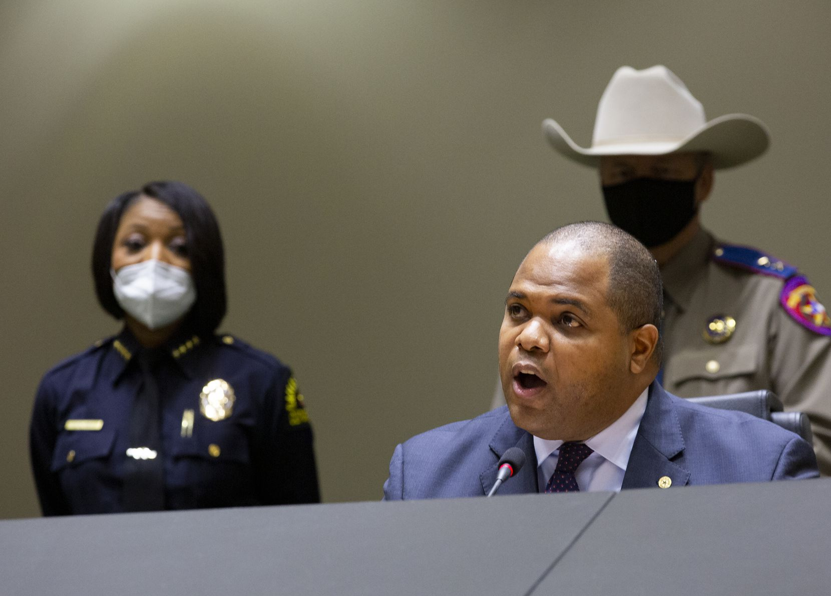 Dallas Police Chief Reneé Hall (left) listens as Dallas Mayor Eric Johnson speaks at a press conference on protest violenceon Tuesday, June 2, 2020 at City Hall. Johnson's budget savings proposal of trimming top salaries in City Hall, which received no support, had not included police employees.