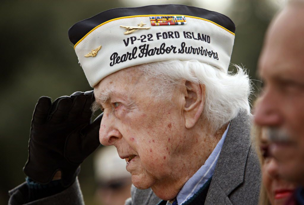 Charles Peters of Euless, who was a career Navy aviator and a Pearl Harbor veteran, salutes during the National Anthem at a ceremony to commemorate the 69th anniversary of the attack, held at Laurel Land Memorial Park December 7, 2010 in Dallas. Peters passed away in April, 2015.