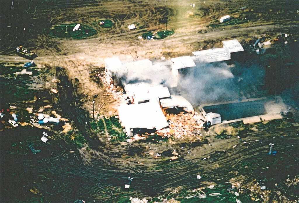 A photo taken from an FBI aircraft just after noon on April 19 as fire first broke out in the compound.