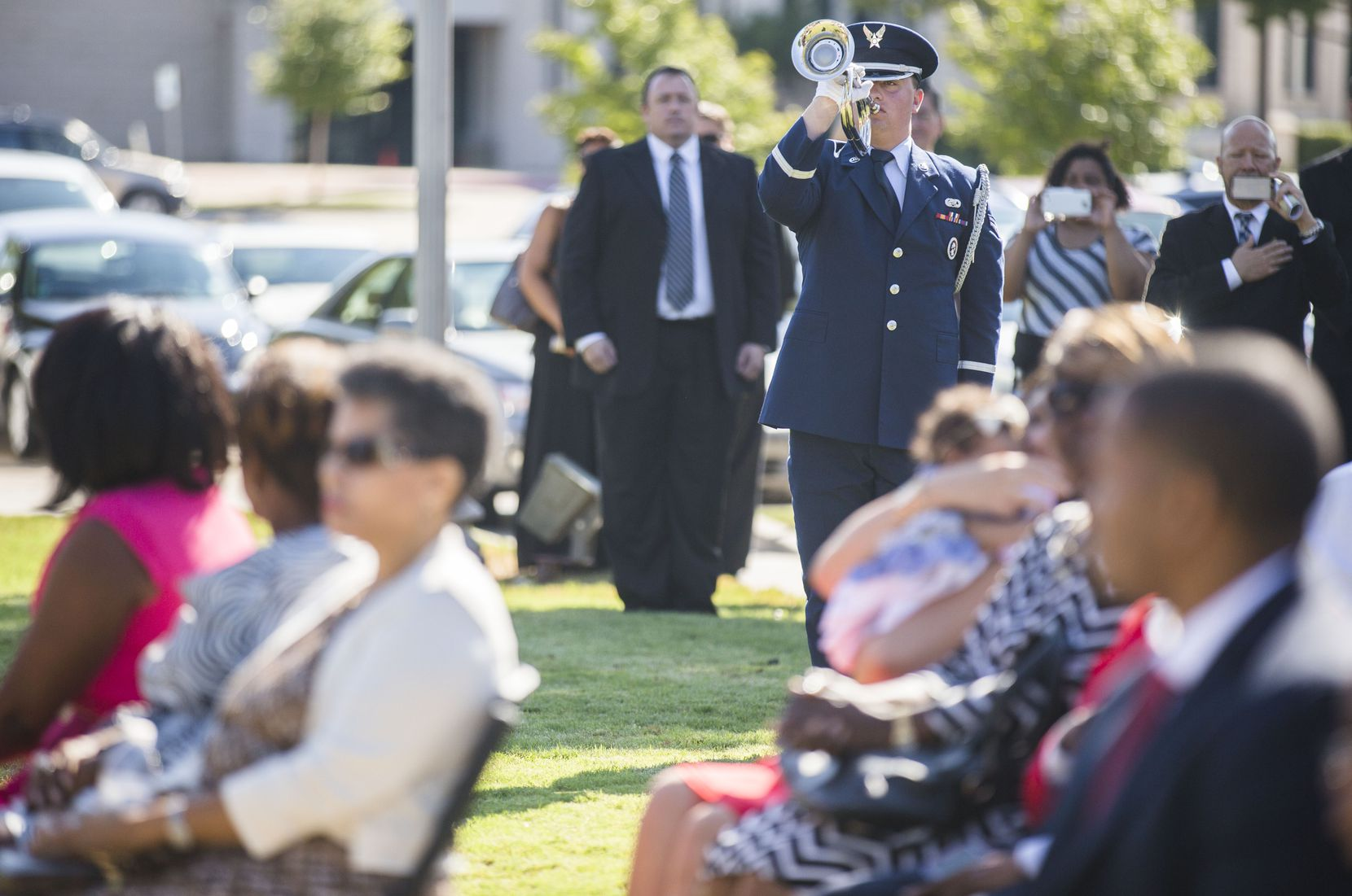 A member of a military honor guard plays a bugle during funeral services for retired Army Air Corps 1st Lieutenant Calvin Spann on Saturday, September 12, 2015 at Covenant Church in Carrollton, Texas.  Spann was an original Tuskegee Airman and fighter pilot with the 100th Fighter Squadron of the 332nd Fighter Group.  He served during World War II, when he flew 26 combat missions. (Ashley Landis/The Dallas Morning News)