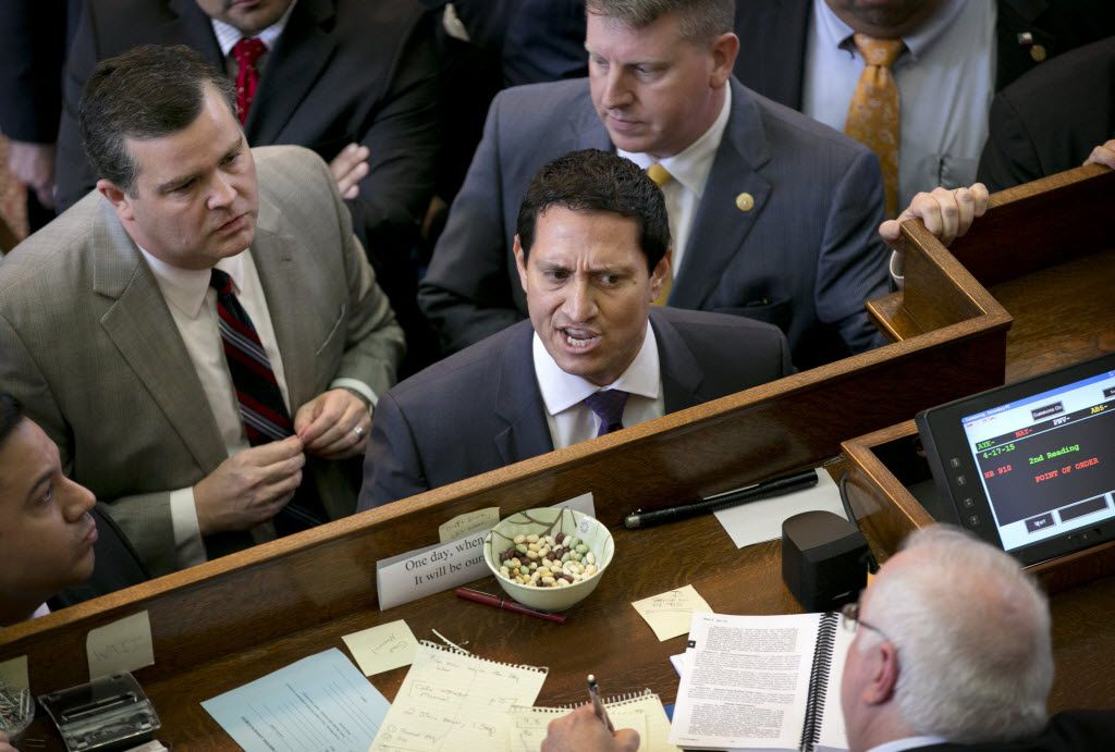 Rep. Trey Martinez Fischer (middle),  shown in a 2015 session debate, said Monday that lawmakers this session have 'plenty of money' and don't need to pass GOP leaders' plan to add a penny to the sales tax.