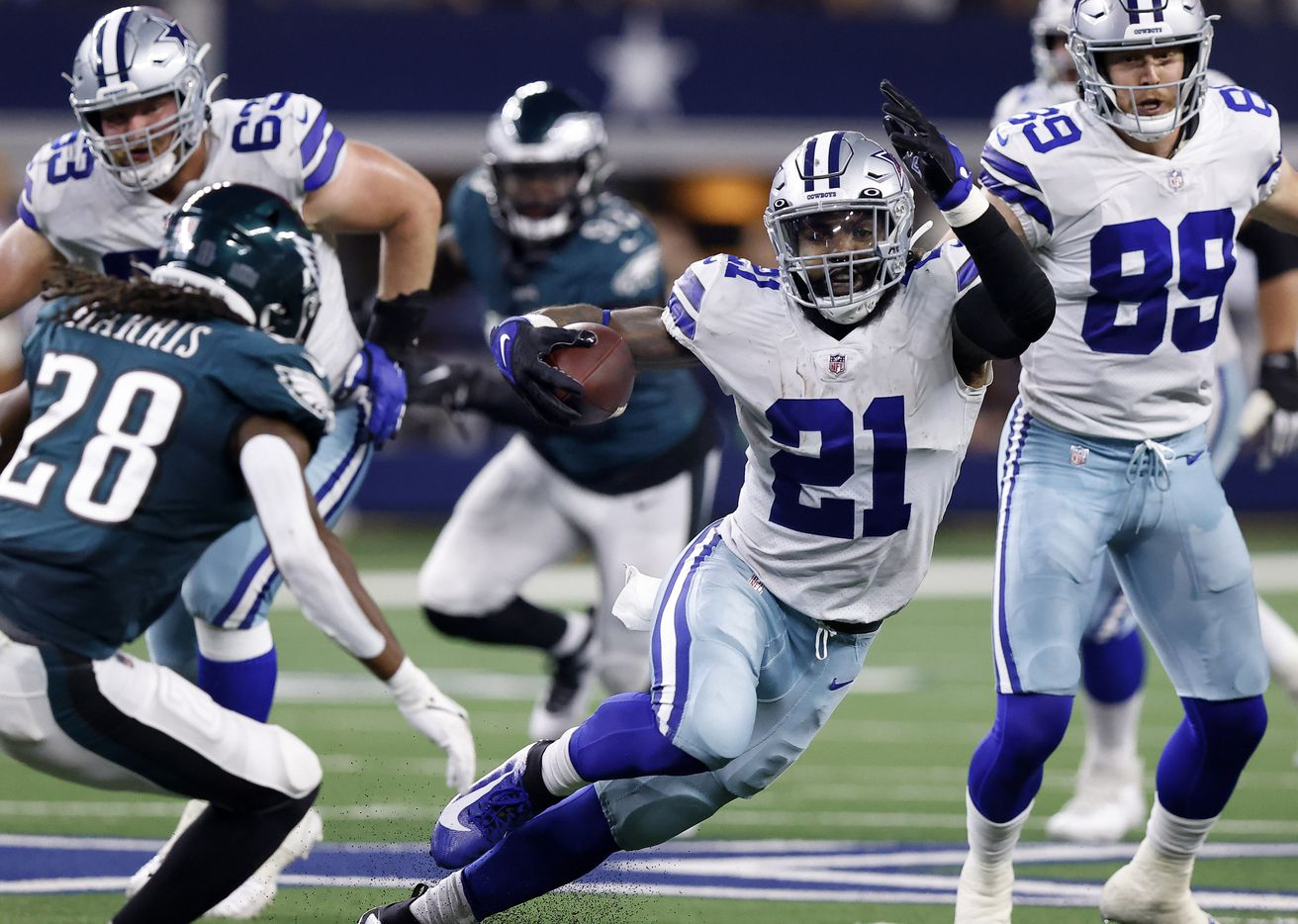 Dallas Cowboys running back Ezekiel Elliott (21) makes a cut to avoid the tackle by Philadelphia Eagles defensive back Anthony Harris (28) during the second quarter at AT&T Stadium in Arlington, Monday, September 27, 2021. (Tom Fox/The Dallas Morning News)