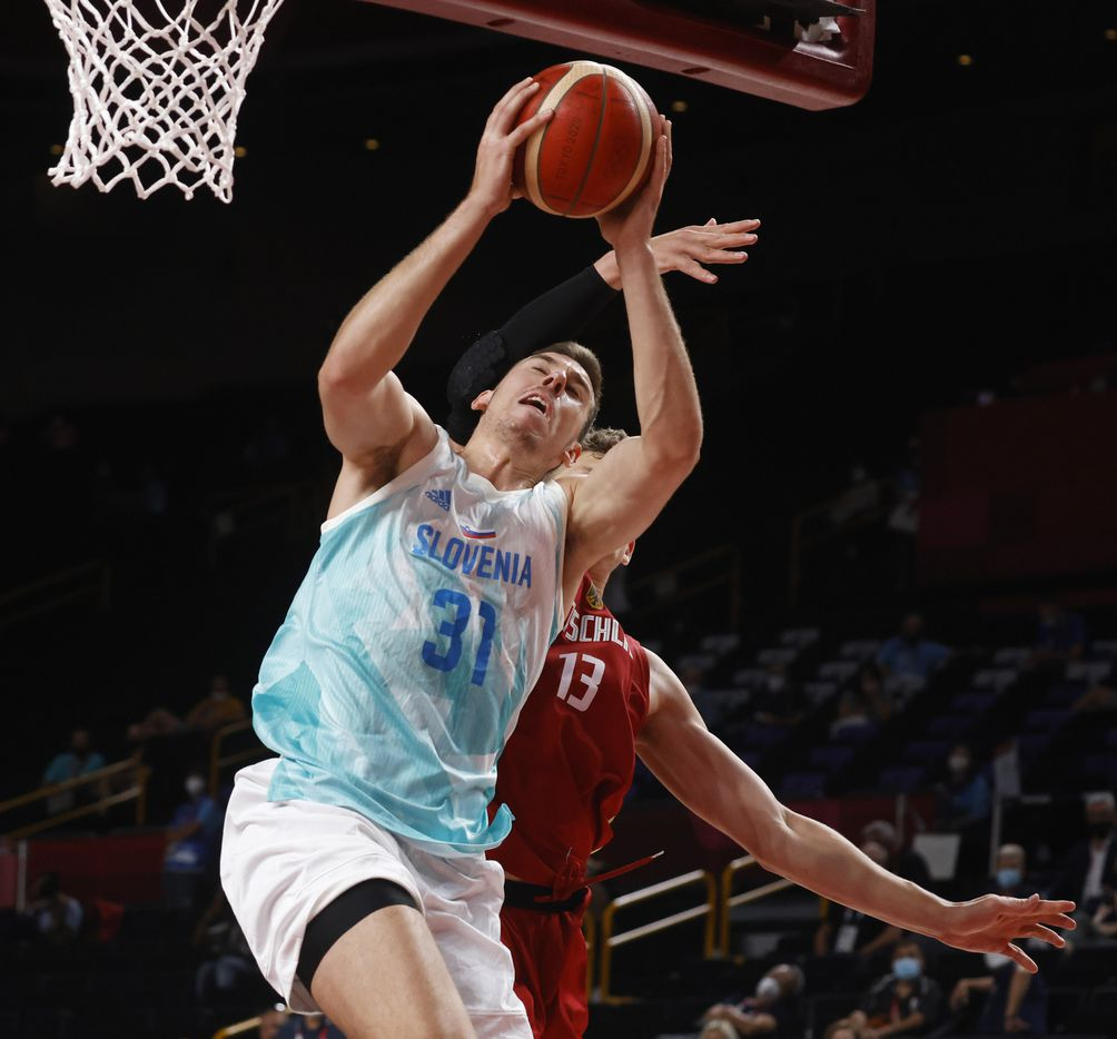 Slovenia's Vlatko Cancer (31) is fouled by Germany's Moritz Wagner (13) during the second half of play of a quarter final basketball game at the postponed 2020 Tokyo Olympics at Saitama Super Arena, on Tuesday, August 3, 2021, in Saitama, Japan. (Vernon Bryant/The Dallas Morning News)