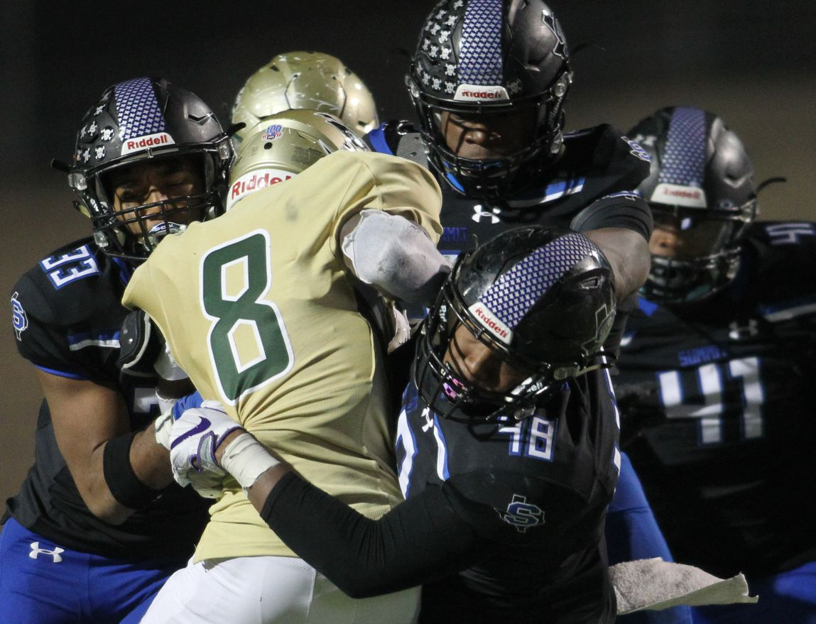 Birdville running back Gracien Anto (8) ran into a pack of Jaguars including defensive lineman Legend Journey (48), linebacker Isaiah Hall (33), defensive end Joseph Adedire (14) and linebacker Johnny Everett (41) during second quarter action. The two teams played their District 4-5A Division l football game at Vernon Newsom Stadium in Mansfield on December 3, 2020. (Steve Hamm/ Special Contributor)
