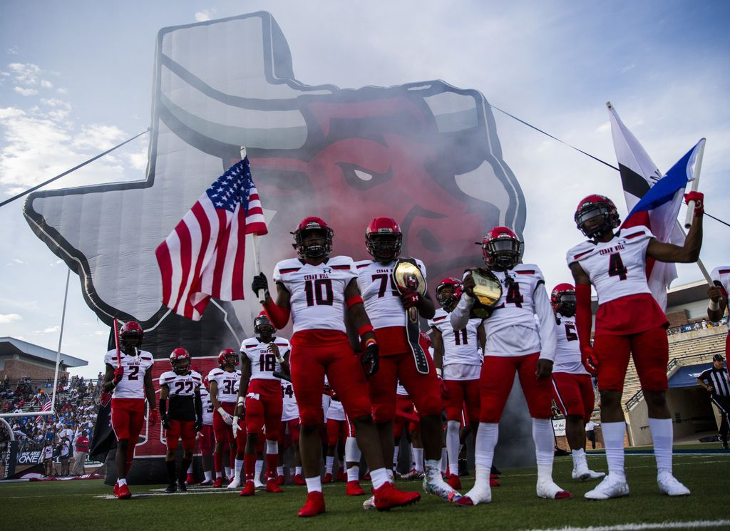 Cedar Hill players prepare to enter the field before a high school football game between Allen and Cedar Hill on Friday, August 30, 2019 at Eagle Stadium in Allen. (Ashley Landis/The Dallas Morning News)