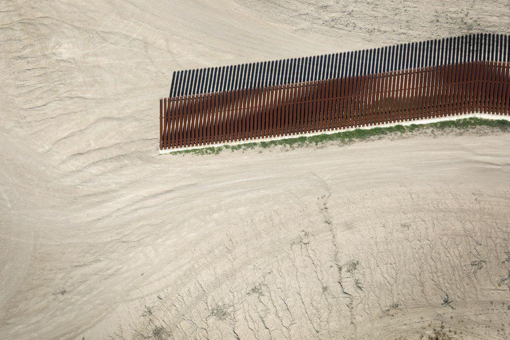 A border fence stops near the U.S.-Mexico border, formed by the Rio Grande; photo taken on Jan. 3, 2017 near McAllen, Texas.