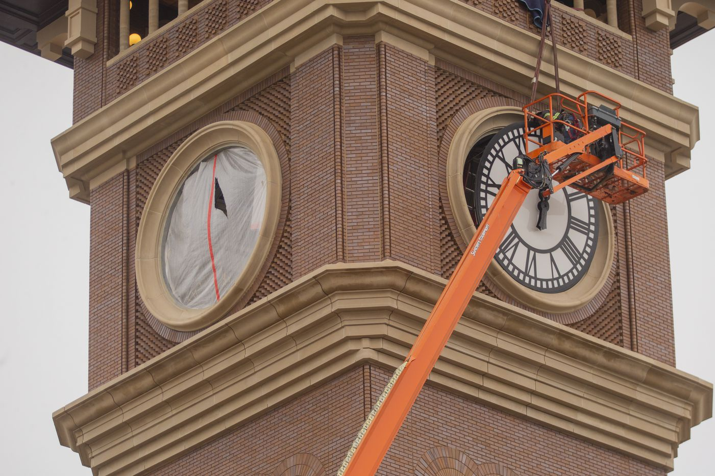 Workers from MEI Rigging & Crating work to install a 12-foot glass clock on the Grapevine Main Station's Observation Tower on Sept. 3, 2020 in Grapevine. The clocks designed by Electric Time Company were designed to be compatible with the Texas-Italianate style of the station. (Juan Figueroa/ The Dallas Morning News)