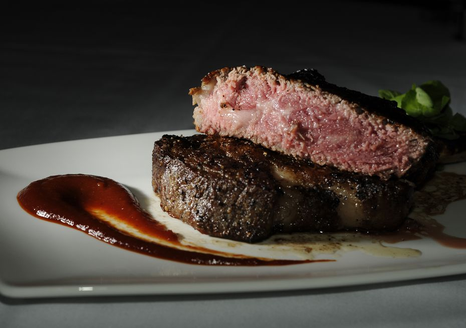 The prime aged cowboy ( A 20-ounce dry-aged bone-in rib eye) at Dakota's Steakhouse in downtown Dallas.