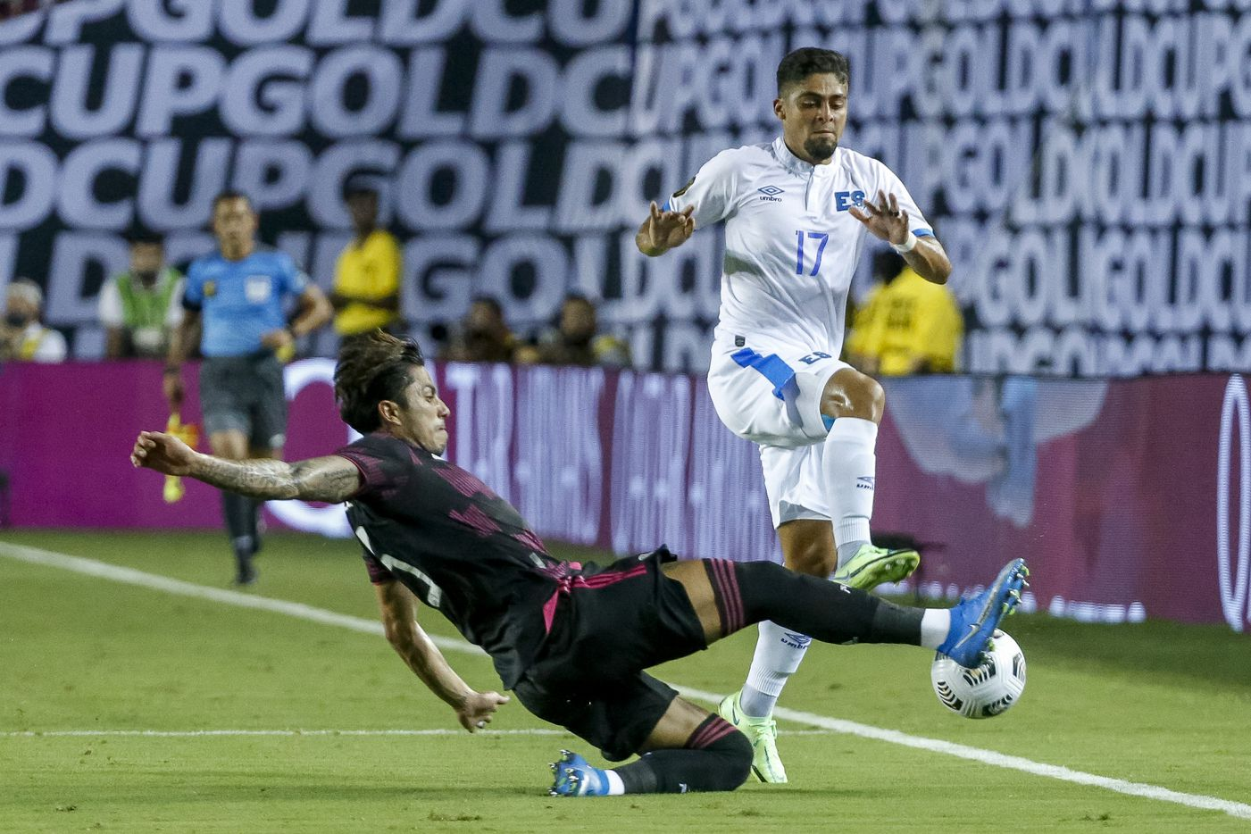 Mexico defender Osvaldo Rodríguez (5) slides into El Salvador midfielder Jairo Henriquez (17) during the first half of a CONCACAF Gold Cup Group A soccer match at the Cotton Bowl on Sunday, July 18, 2021, in Dallas. (Elias Valverde II/The Dallas Morning News)