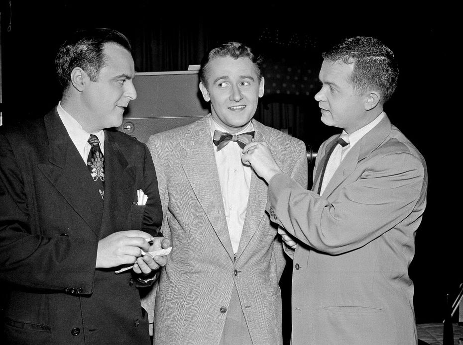 Hollywood reporters Herb Stein (left) and Bob Thomas (right) interview Alan Young on the set of The Alan Young Show in Los Angeles.