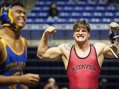 Mason Ding of Carrollton Creekview celebrates after defeating Kelby Hickerson of Austin Anderson for the 5A boys 220-pound championship during the UIL State Wrestling tournament at the Berry Center on Friday, April 23, 2021, in Cypress, Texas.