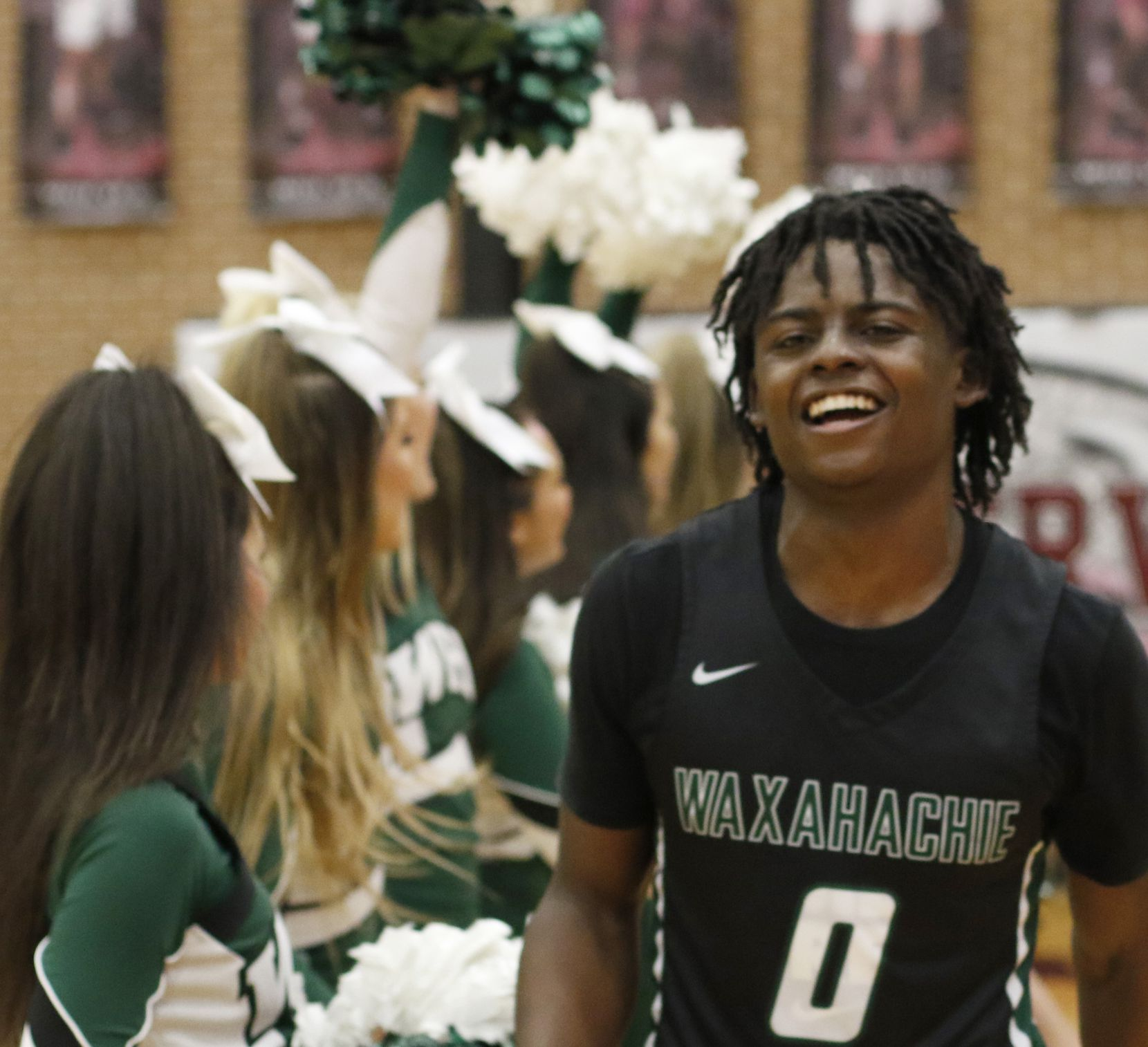 Waxahachie guard BJ Francis (0) was all smiles as he runs through a spirit line of cheerleaders following their 62-50 victory over Coppell to advance. The two teams played their Class 6A area-round boys basketball playoff game at Mansfield Timberview High School in Arlington on February 28, 2020.