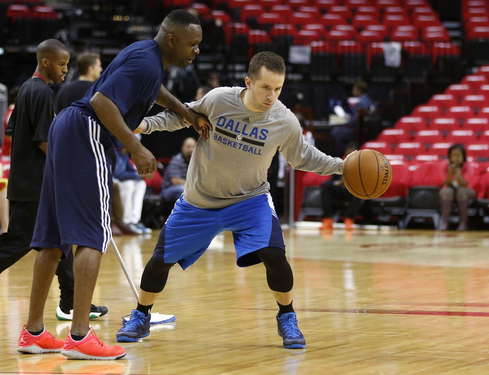 Dallas Mavericks guard J.J. Barea (5) works out with assistant coach Darrell Armstrong before game 1 against the Houston Rockets in the first round of the NBA playoffs at Toyota Center in Houston on Saturday, April 18, 2015. (Vernon Bryant/The Dallas Morning News)