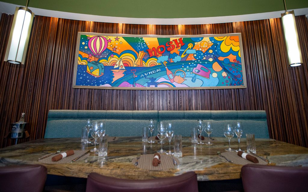 A custom mural in the style of Peter Max