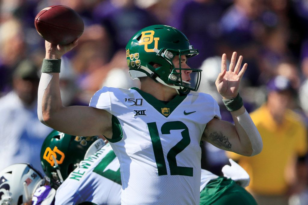 Baylor quarterback Charlie Brewer (12) passes to a teammate during the first half of an NCAA college football game against Kansas State in Manhattan, Kan., Saturday, Oct. 5, 2019. (AP Photo/Orlin Wagner)