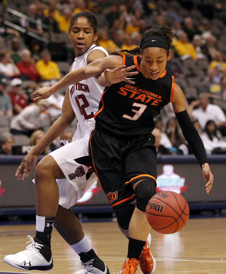 Oklahoma State Cowgirls guard Tiffany Bias (3) drives towards the basket as she is defended by Texas Tech Lady Raiders forward Jackie Patterson (42) in the first half of play during the Big 12 Women's Basketball Championship at the American Airlines Center in Dallas on March 9, 2013. (Vernon Bryant/The Dallas Morning News)