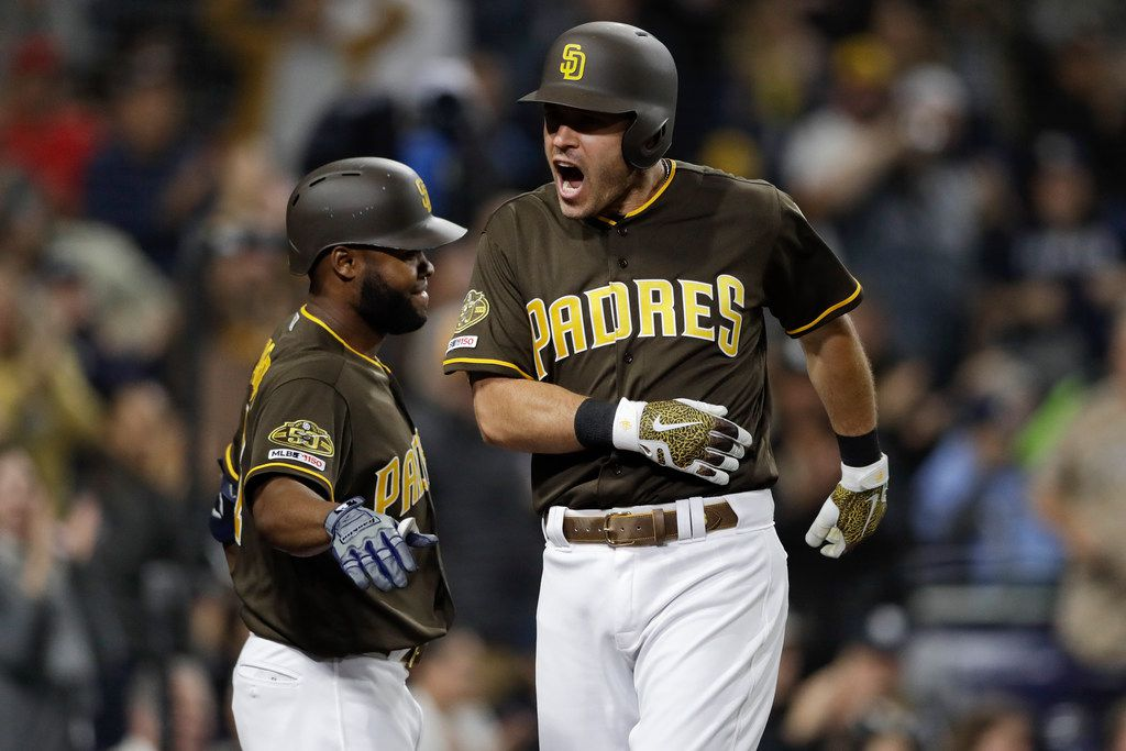 San Diego Padres' Ian Kinsler, right, reacts with teammate Manuel Margot after hitting a home run during the seventh inning of a baseball game against the Miami Marlins, Friday, May 31, 2019, in San Diego. (AP Photo/Gregory Bull)