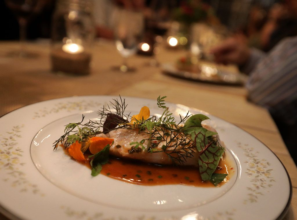 Cartermere Farms chicken breast with chicken jus and greenhouse-grown herbs and nasturtium petals.. (Jason Janik/Special Contributor)