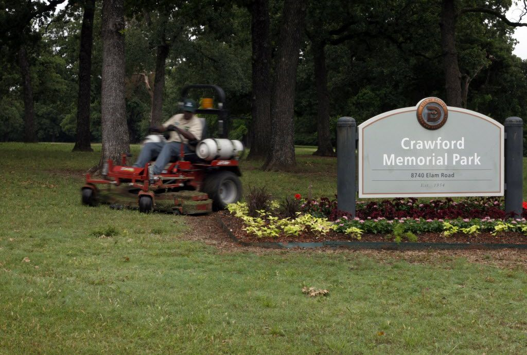 Photo taken 5/21/10 of a maintenance worker mowing at Crawford Memorial Park on Elam Rd. in Dallas. Due to budget shortages Dallas Parks and Recreations will only be able to cut park grass once a month and pick up litter once a week. (Photo by Lawrence Jenkins/Special contributor)