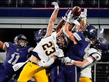 Highland Park defensive back Andrew Bonnet (23) and Frisco Lone Star wide receiver Trace Buckler (4) fight for the ball on a Hail Mary pass on the final play of regulation to force overtime in a Class 5A Division I Region II semifinal playoff football game at AT&T Stadium non Friday, Nov. 29, 2019, in Arlington.