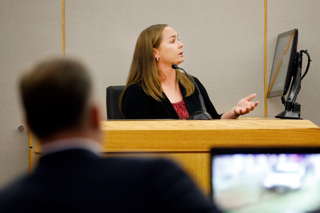 Sgt. Breanna Valentine responds to questions from District Judge Tammy Kemp during a hearing outside the presence of jurors Tuesday.