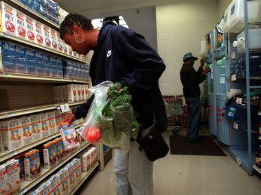 In this file photo, Peggy Jones shops for soy milk at Ann's Health Food Center and Market in Oak Cliff. The longtime business plans to open another store soon.
