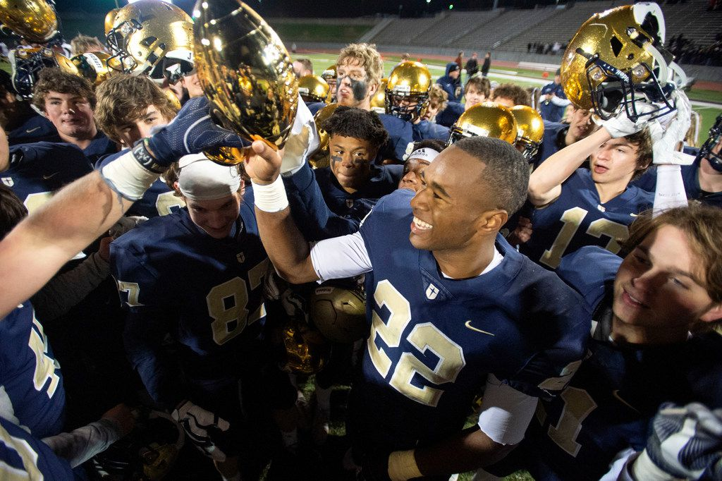 Jesuit senior running back E.J. Smith (22) raises the trophy after his team's 27-25 victory over defending state champions Longview in an area round high school football playoff game on Friday, November 22, 2019 at John Kincaide Stadium Dallas. Smith accounted for all of Jesuit's points with four rushing touchdowns. (Jeffrey McWhorter/Special Contributor)