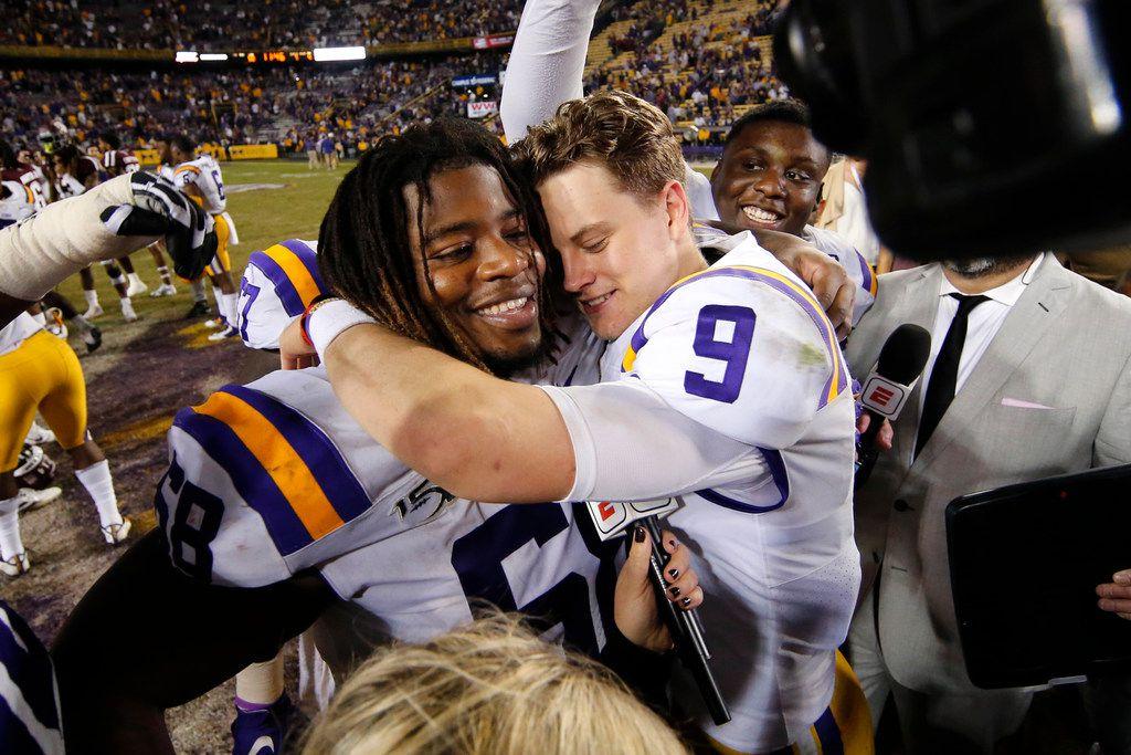 LSU quarterback Joe Burrow (9) hugs guard Damien Lewis after the team's NCAA college football game against Texas A&M in Baton Rouge, La., Saturday, Nov. 30, 2019. LSU won 50-7. (AP Photo/Gerald Herbert)