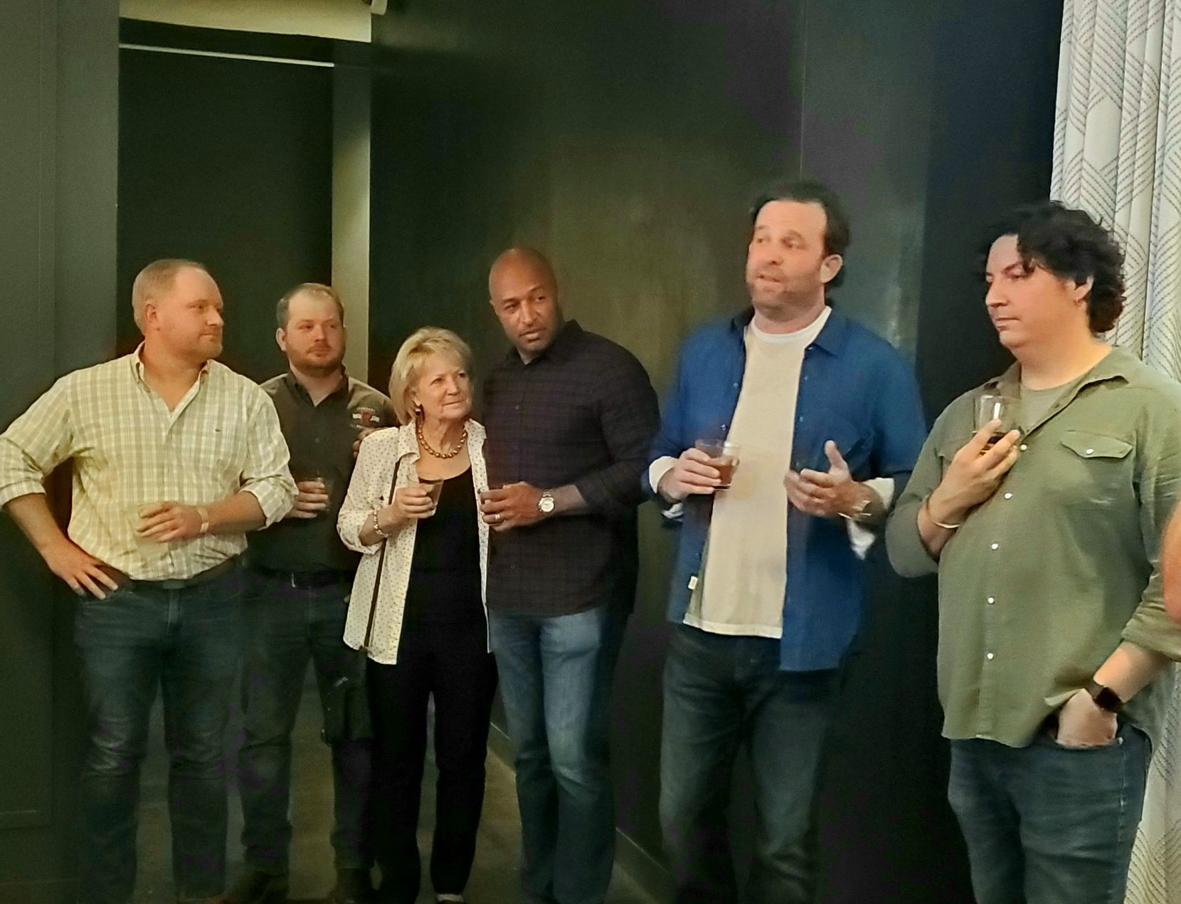 Grayson Bourbon's Brandon Davis, flanked by fellow co-founders Vernon Davis, at left, and Nico Martini, at right, addresses the crowd at this month's launch celebration for the Texas whiskey. The just-released spirit is a blend of barrels from some of the state's best distilleries, including Denison's Ironroot Republic, whose team -- brothers Jonathan and Robert Likarish, and their mother Marcia -- is at far left.