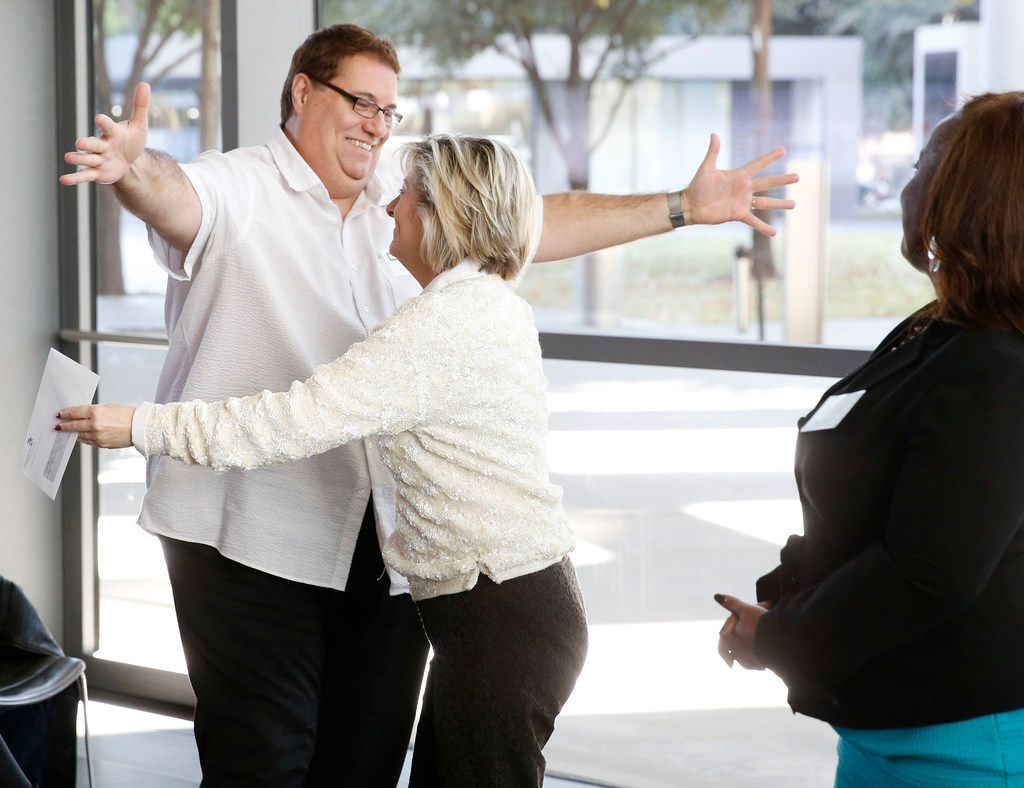 Bob Sweeney of Dallas Life Foundation gives a hug to Camille Grimes (left), executive director, The Dallas Morning News Charities as he receives a check during the The Dallas Morning News Charities 2018-19 Campaign Kickoff Reception at the Winspear Opera House in Dallas on Wednesday, November 14, 2018. (Vernon Bryant/The Dallas Morning News)