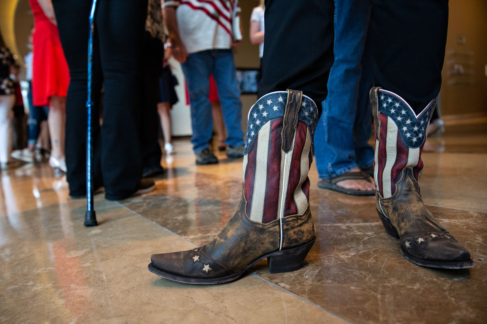 Karmen Siirtola donned patriotic boots for opening night of the conference at the Omni Dallas Hotel.