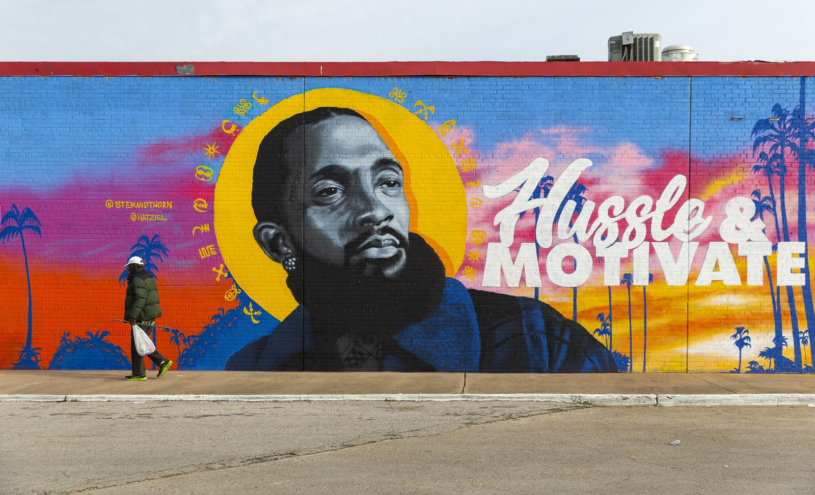 A mural dedicated to the late rapper, entrepreneur and community activist Nipsey Hussle by artists Jeremy Biggers and Hatziel Flores at the Glendale Shopping Center on Feb. 22, 2020 in Dallas. (Juan Figueroa/ The Dallas Morning News)