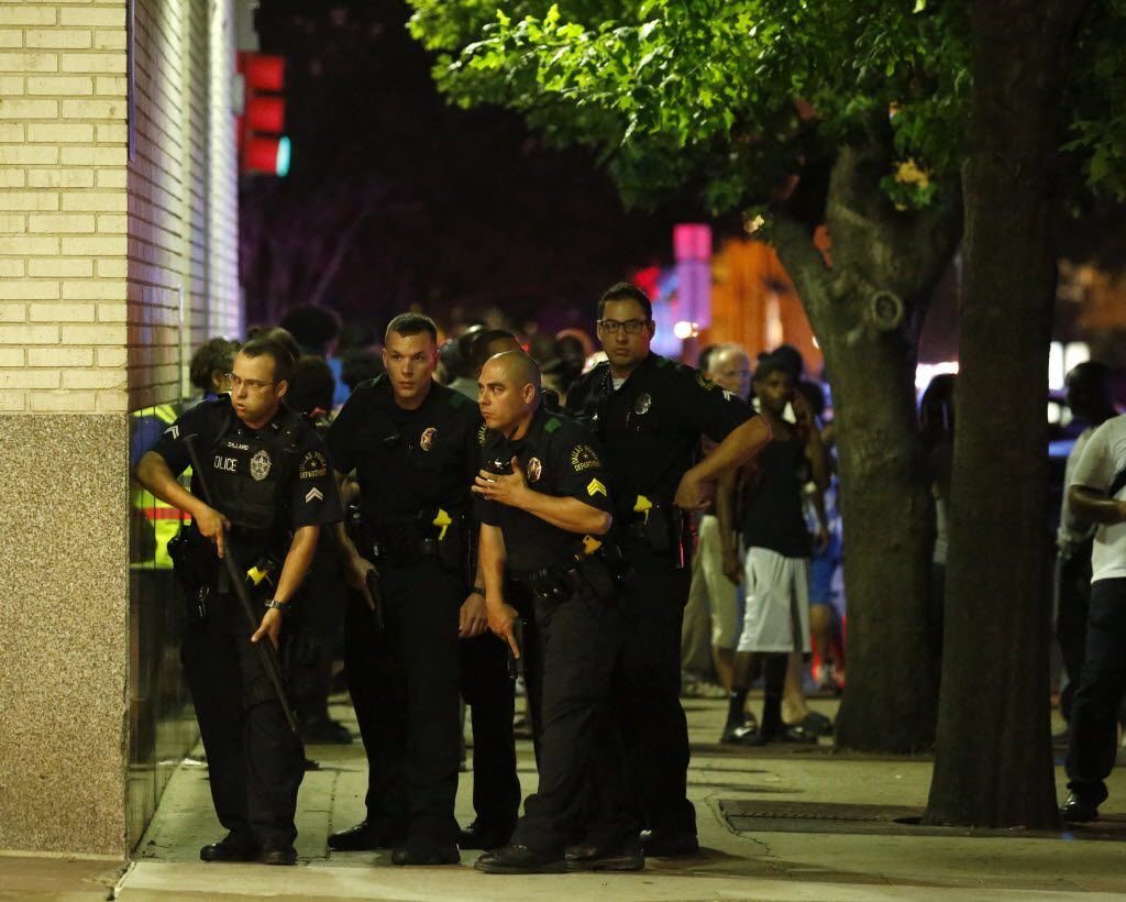 Dallas Police respond after shots were fired at a Black Lives Matter rally in downtown Dallas on Thursday, July 7, 2016. Dallas protestors rallied in the aftermath of the killing of Alton Sterling by police officers in Baton Rouge, La. and Philando Castile, who was killed by police less than 48 hours later in Minnesota. (G.J. McCarthy/The Dallas Morning News) -- MANDATORY CREDIT, NO SALES, MAGS OUT, TV OUT, INTERNET USE BY AP MEMBERS ONLY