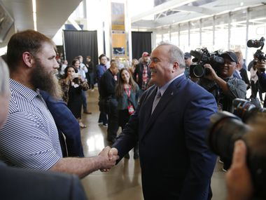 FILE - Cowboys center Travis Frederick (72) meets new head coach Mike McCarthy after his introductory press conference in the Ford Center at The Star in Frisco on Wednesday, Jan. 8, 2020.