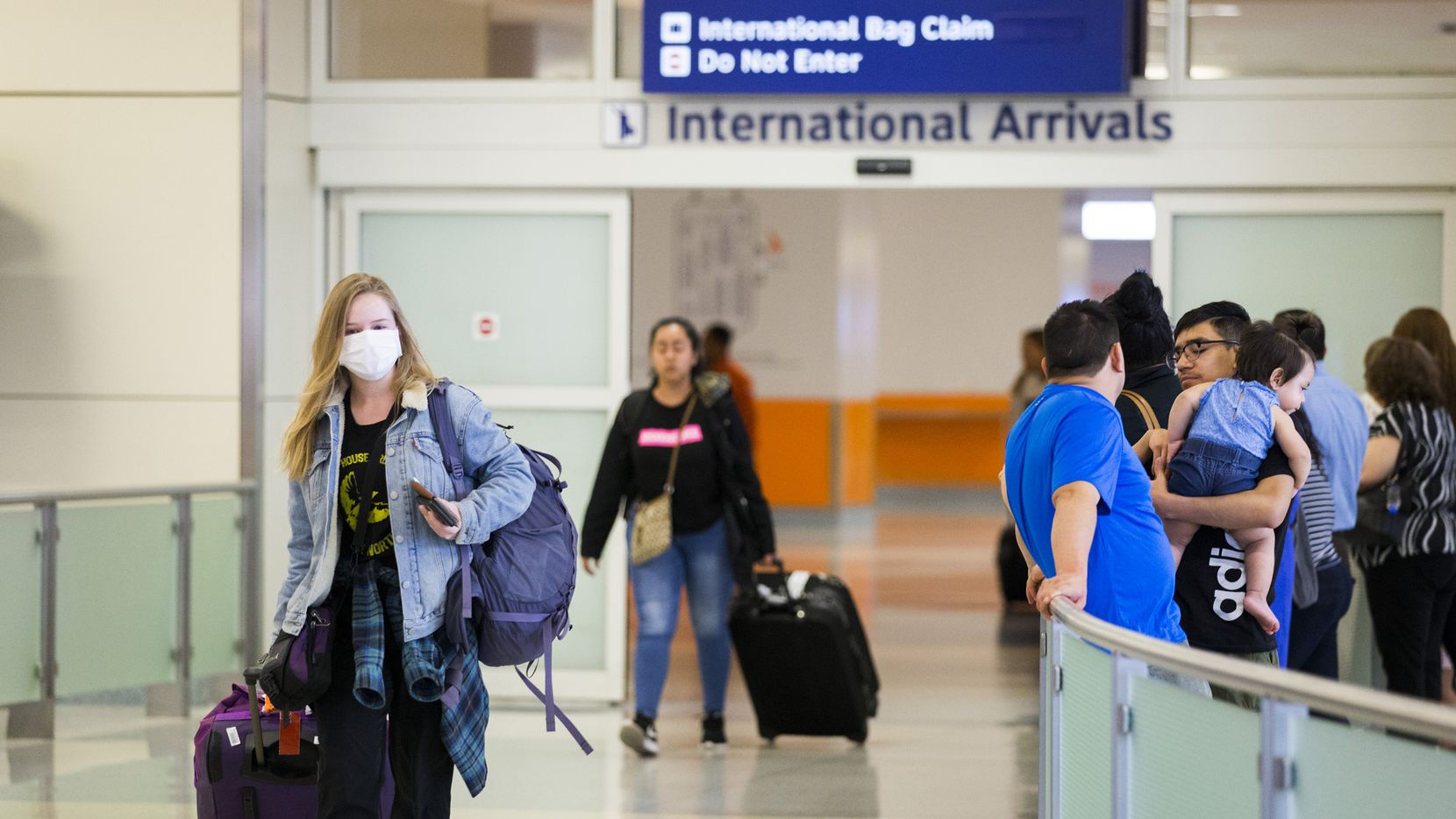 International travelers arrived at Terminal D at DFW International Airport on March 12, 2020. Travel from Europe has been restricted due to the spread of coronavirus.
