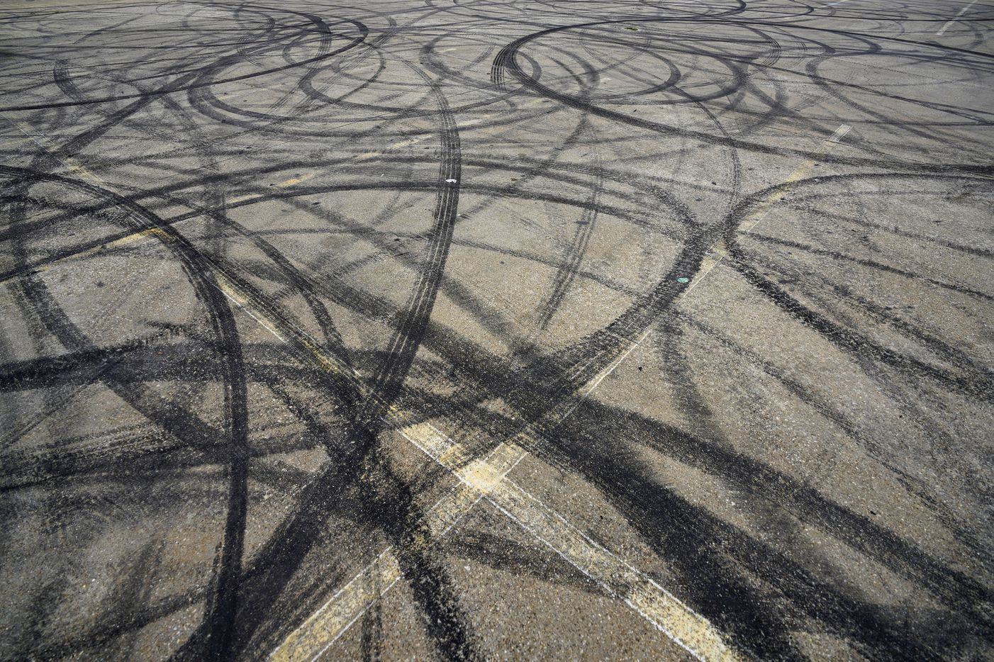 Skid marks are seen in a parking lot at 1400 S. Henderson Avenue on Monday, March 9, 2020, in Dallas.