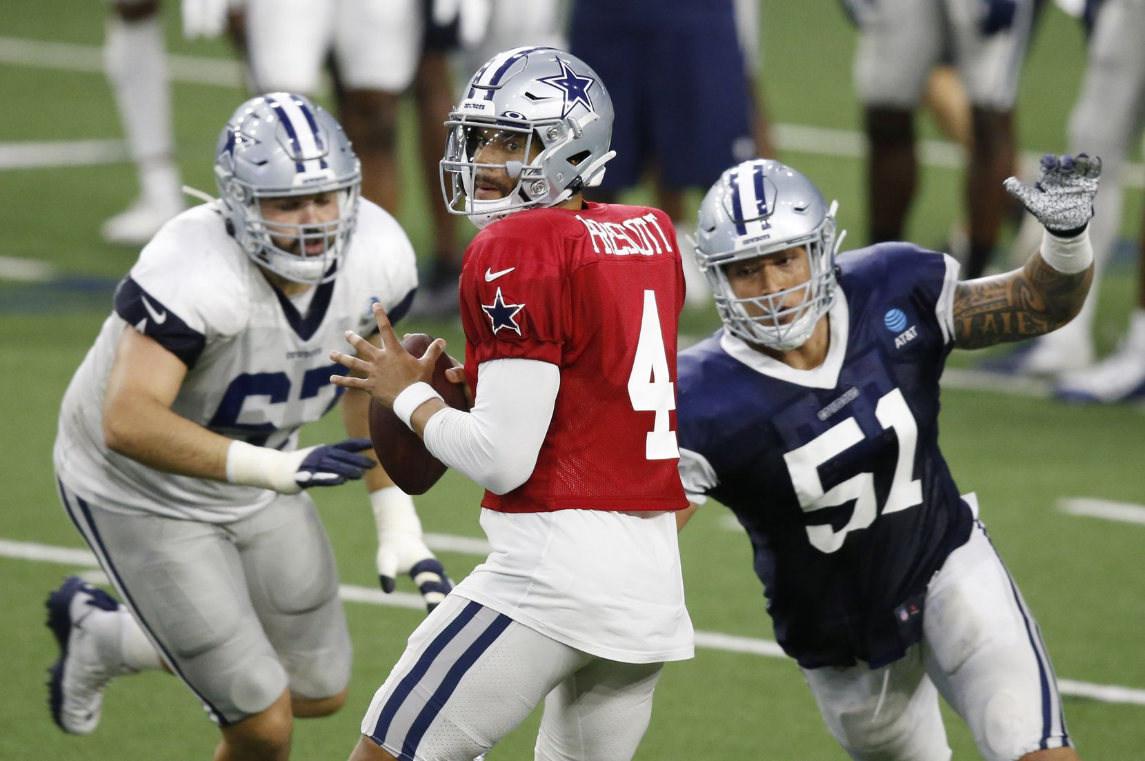 Dallas Cowboys quarterback Dak Prescott (4) looks to pass as Dallas Cowboys defensive end Bradlee Anae (51) closes in on him during training camp at the Dallas Cowboys headquarters at The Star in Frisco, Texas on Thursday, August 27, 2020. (Vernon Bryant/The Dallas Morning News)