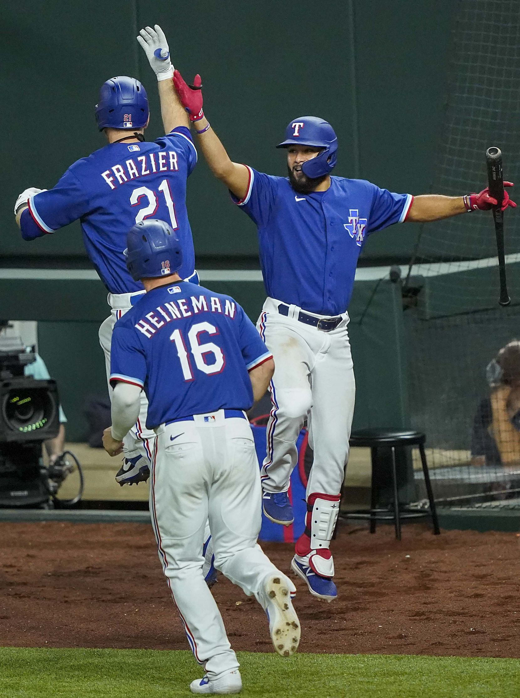 Texas Rangers first baseman Todd Frazier celebrates with Isiah Kiner-Falefa after hitting a 3-run home run during the fifth inning of an exhibition game against the Colorado Rockies at Globe Life Field on Wednesday, July 22, 2020.