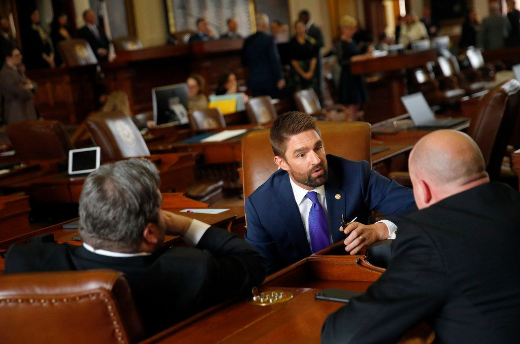 Rep. Jeff Leach, R-Collin County visits with colleagues in the House of Representatives at the Texas State Capitol in Austin, Wednesday, February 27, 2019.