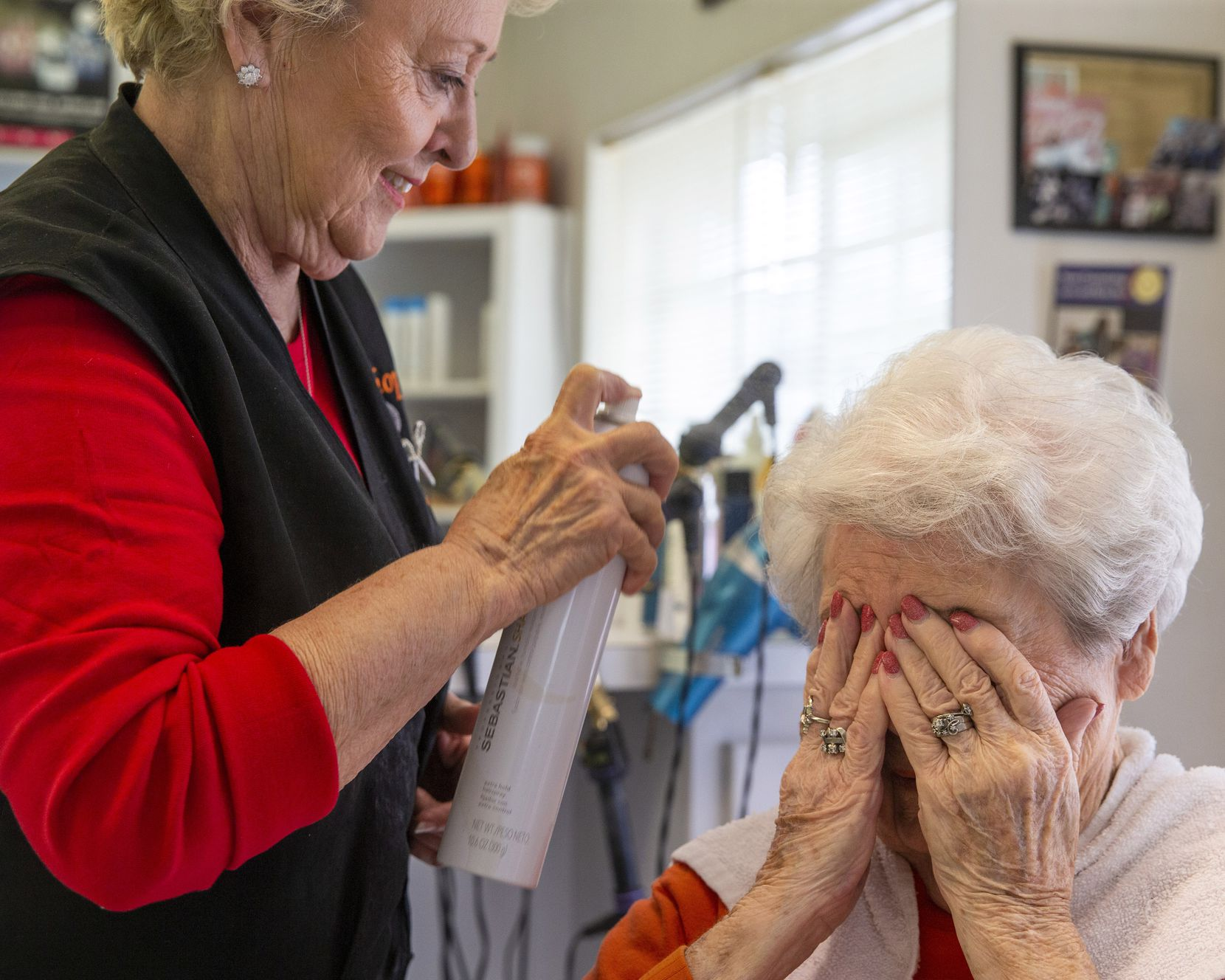 """Shirley O'Neal (left) set Peralea Pell's hair with hair spray at Shirley's Hair Shop in Celina on Nov. 21, 2019. O'Neal calls Pell a """"lifer,"""" because she's been a client of hers since 1966, when she first opened her shop. """"Let me spray you one more time since it's muggy out there!"""" O'Neal told Pell."""