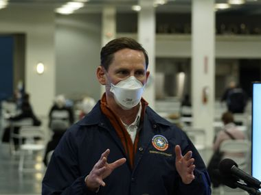 Judge Clay Jenkins speaks to the media from the post vaccine observation room at the Tower Building at Fair Park in Dallas, Texas on Thursday January 28, 2021.