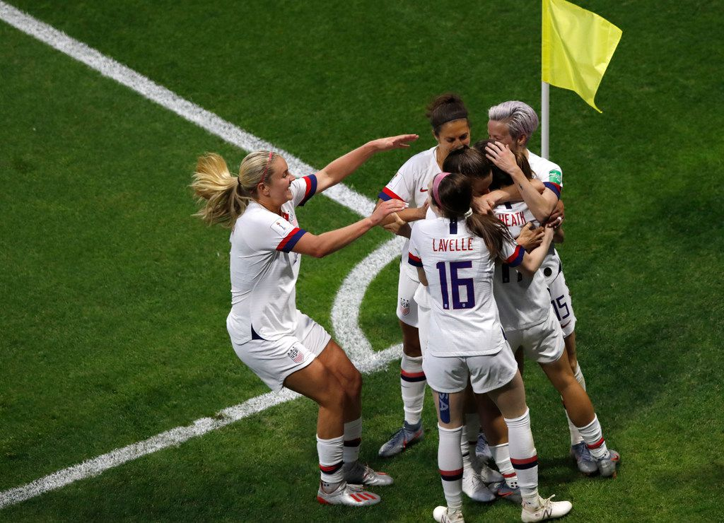 US players celebrate after teammate Tobin Heath scored their side's second goal during the Women's World Cup Group F soccer match between the United States and Sweden at the Stade Oceane in Le Havre, France, Thursday, June 20, 2019. (AP Photo/Christophe Ena)