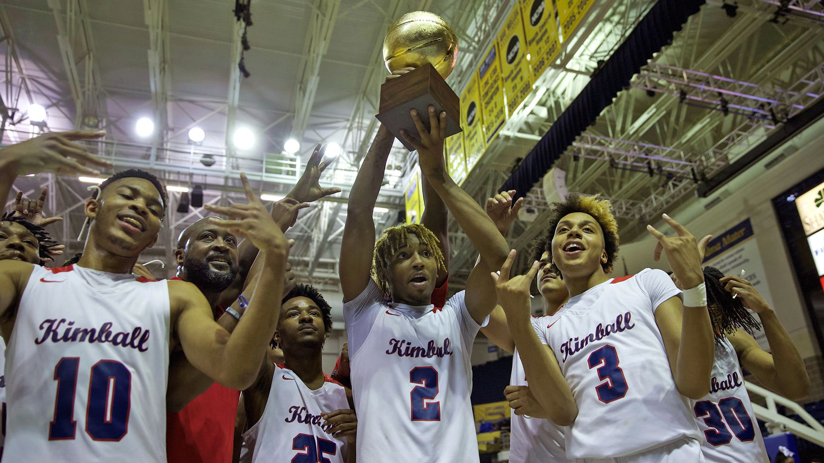 Players and coaches for Kimball celebrate a win over Amarillo in the UIL 5A state semifinal game against Amarillo in San Angelo, TX on Tuesday, March 9, 2021.