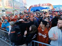 FILE - Texas long snapper Justin Mader (54) greets family members as the team makes its way to the Cotton Bowl for the Red River Showdown against Oklahoma on Saturday, Oct. 12, 2019, in Dallas.