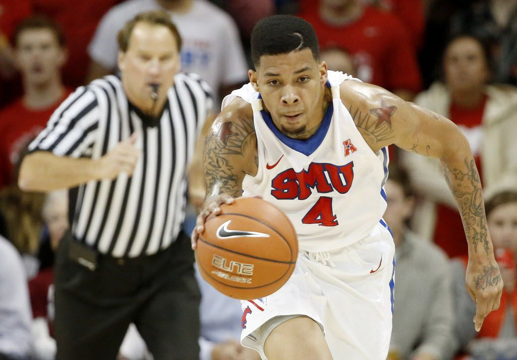 SMU guard Keith Frazier (4) travels up the court in the first half during an NCAA basketball game between Arkansas and SMU at Moody Coliseum in Dallas Tuesday November 25, 2014. Arkansas  beat SMU 78-72. (Andy Jacobsohn/The Dallas Morning News)