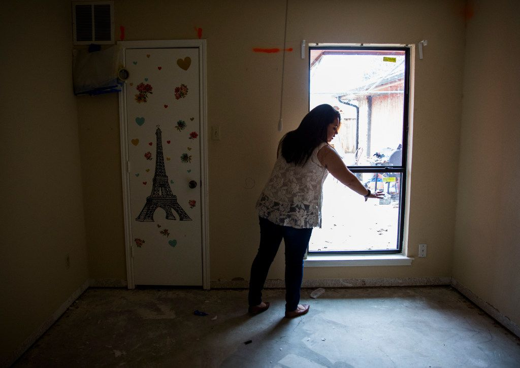 Jenny Vega describes how a tree branch broke a window in her daughter, Trinity's room on Kelso Lane in Garland.