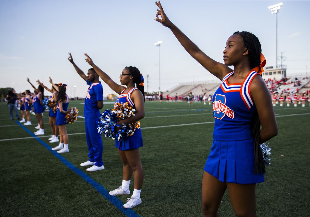 Arlington Bowie cheerleaders sing the school song before a high school football game between Flower Mound Marcus and Arlington Bowie on Thursday, August 29, 2019 at Wilemon Field in Arlington. (Ashley Landis/The Dallas Morning News)