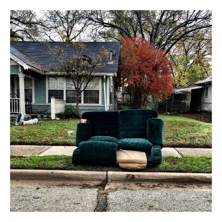 A couch lies discarded on the curb, one of many shots the photographer captured on his Meals on Wheels volunteer route.